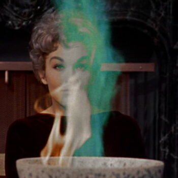 Kim Novak with flame in cauldron