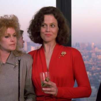 Eighties Melanie Griffiths and Sigourney Weaver standing together for Working Girl movie