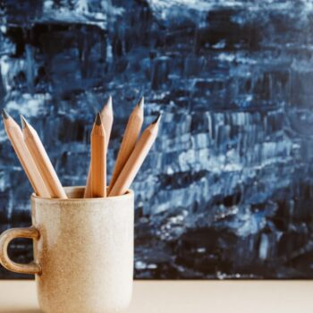 The zodiac sign Virgo symbolized by earthenware mug with sharpened pencils